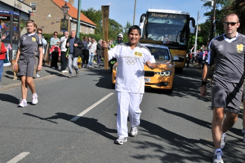 Simran Vedvyas, the youngest torchbearer from UAE, gracefully carried the Olympic Flame during the London 2012 Olympic Games at Hinderwell United Kingdom, on 18th June 2012
